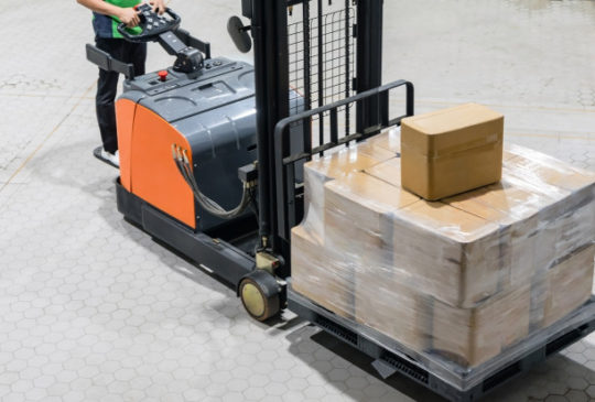 electrical-forklift-truck-with-boxes-pallet-warehouse_29285-477